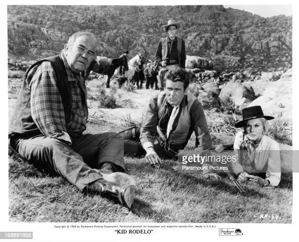 Broderick Crawford Don Murray Richard Carlson and Janet Leigh sit in a field in a scene from the film 'Kid Rodelo' 1966