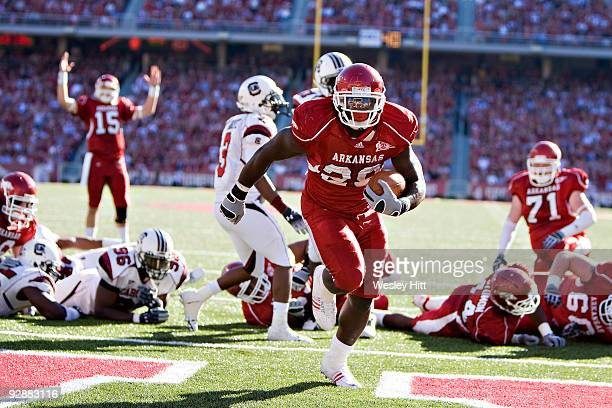Broderick Green of the Arkansas Razorbacks scores a touchdown against the South Carolina Gamecocks at Donald W Reynolds Stadium on November 7 2009 in...