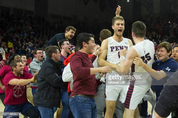 Brodeur and Max Rothschild of the Pennsylvania Quakers celebrate their win against the Villanova Wildcats at The Palestra on December 11, 2018 in...