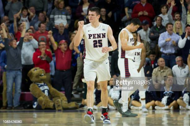 Brodeur Michael Wang and Antonio Woods of the Pennsylvania Quakers react in front of mascot Will D Cat of the Villanova Wildcats at The Palestra on...