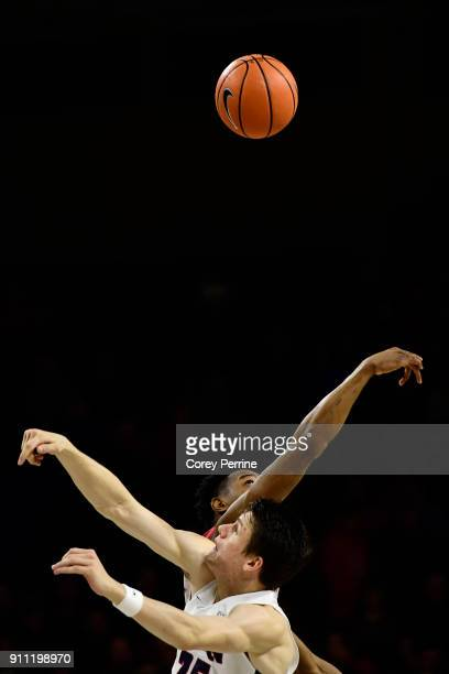 Brodeur of the Pennsylvania Quakers and James Demery of the Saint Joseph's Hawks tipoff during the first half at The Palestra on January 27, 2018 in...