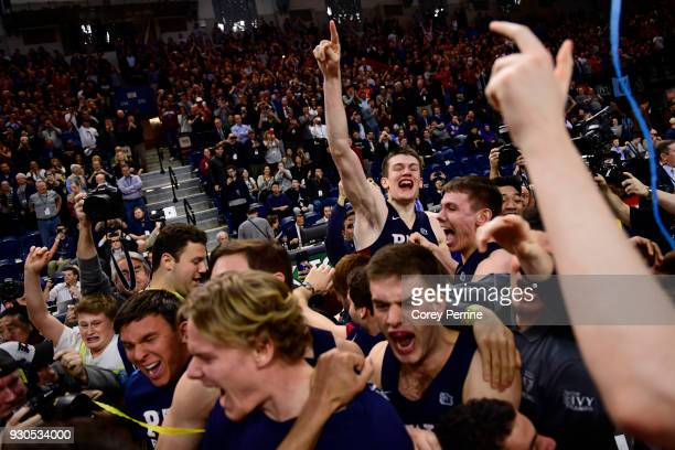 Brodeur of the Pennsylvania Quakers celebrates with his teammates after winning the Men's Ivy League Championship Tournament at The Palestra on March...