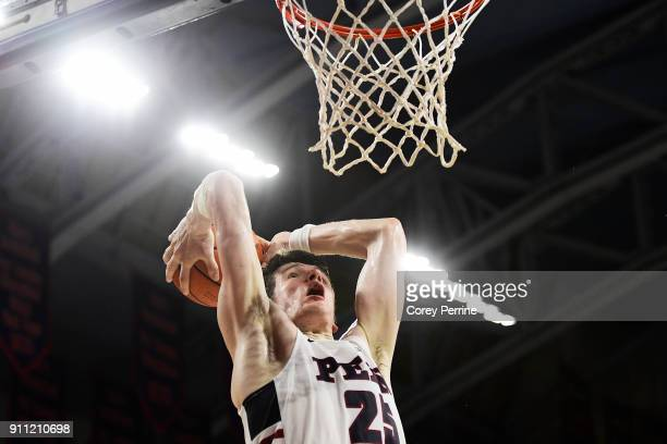 Brodeur of the Pennsylvania Quakers closes the game with an uncontested dunk against the Saint Joseph's Hawks during the second half at The Palestra...