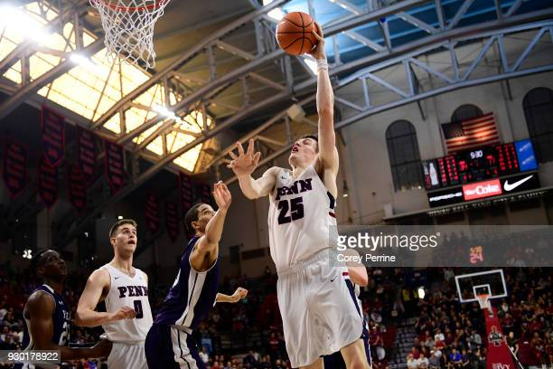 Brodeur of the Pennsylvania Quakers drives to the basket against the Yale Bulldogs during the first half of a semifinal round matchup in the Ivy...