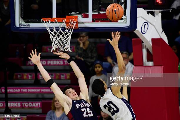 Brodeur of the Pennsylvania Quakers fouls Paul Atkinson of the Yale Bulldogs in the lane during the second half at The Palestra on February 3 2018 in...