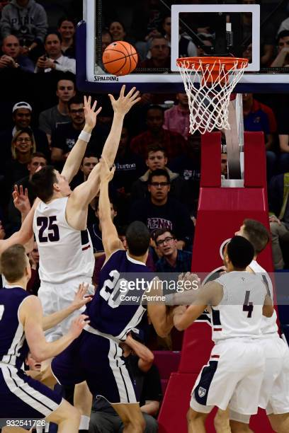 Brodeur of the Pennsylvania Quakers grabs a rebound against Paul Atkinson of the Yale Bulldogs during the first half of a semifinal round matchup in...