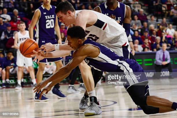 Brodeur of the Pennsylvania Quakers has the ball knocked form his hands by Trey Phills of the Yale Bulldogs during the second half of a semifinal...