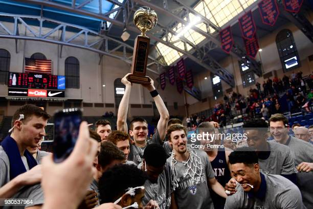 Brodeur of the Pennsylvania Quakers hoists the championship trophy after winning the Men's Ivy League Championship Tournament with teammates at The...