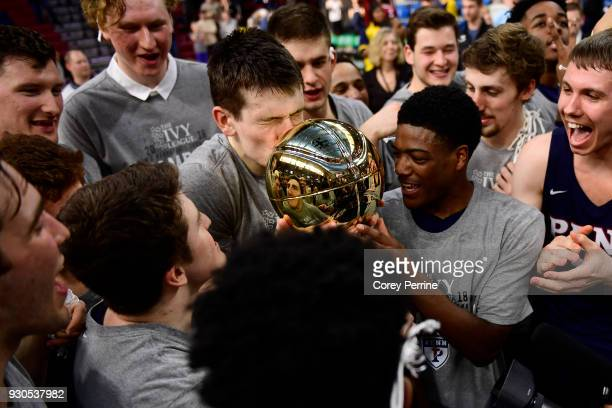Brodeur of the Pennsylvania Quakers kisses the championship trophy hard after winning the Men's Ivy League Championship Tournament with teammates at...