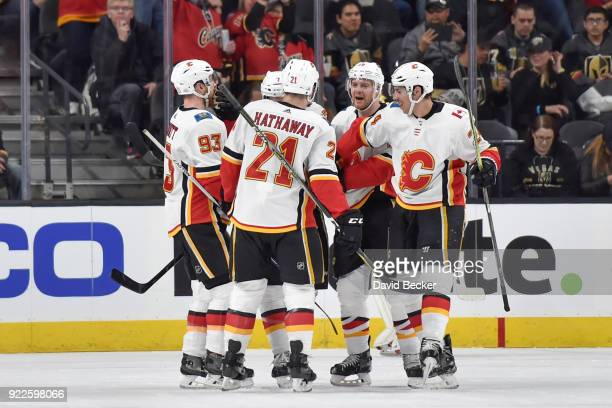 J Brodie celebrates his goal with his teammates Sam Bennett Garnet Hathaway Matt Stajan and Travis Hamonic of the Calgary Flames against the Vegas...