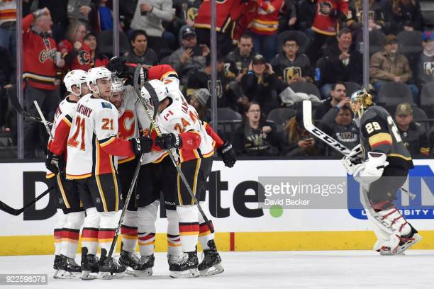 J Brodie celebrates his goal with his teammates Sam Bennett Garnet Hathaway Matt Stajan and Travis Hamonic of the Calgary Flames as MarcAndre Fleury...