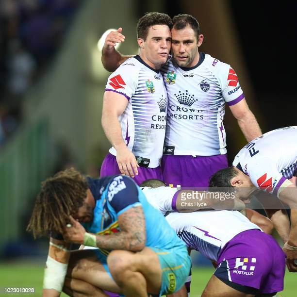 Brodie Croft and Cameron Smith celebrate winning the round 24 NRL match between the Gold Coast Titans and the Melbourne Storm at Cbus Super Stadium...
