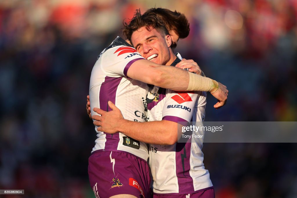 Brodie Croft of the Storm celebrates a try with a team mate during the round 24 NRL match between the Newcastle Knights and the Melbourne Storm at McDonald Jones Stadium on August 19, 2017 in Newcastle, Australia.