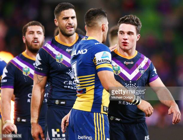 Brodie Croft of the Storm celebrates the win with a defeated Corey Norman of the Eels during the round 23 NRL match between the Melbourne Storm and...
