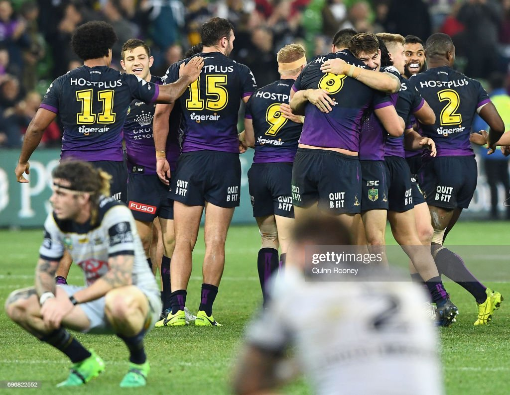 Brodie Croft of the Storm is congratulated by team mates after kicking the winning field goal during the round 15 NRL match between the Melbourne Storm and the North Queensland Cowbpys at AAMI Park on June 17, 2017 in Melbourne, Australia.