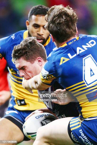 Brodie Croft of the Storm is tackled by Clinton Gutherson of the Eels during the round 23 NRL match between the Melbourne Storm and the Parramatta...