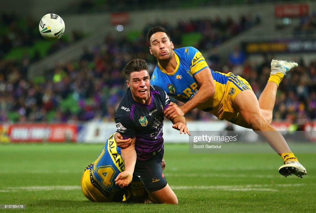 Brodie Croft of the Storm is tackled by Corey Norman of the Eels during the round 18 NRL match between the Melbourne Storm and the Parramatta Eels at AAMI Park on July 8, 2017 in Melbourne, Australia.