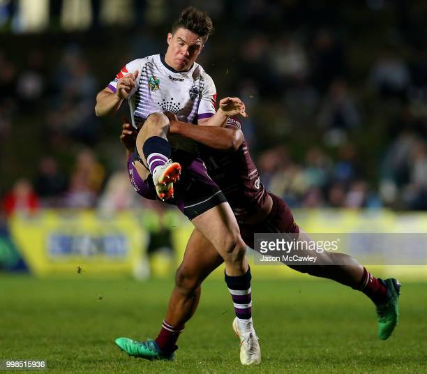 Brodie Croft of the Storm is tackled during the round 18 NRL match between the Manly Sea Eagles and the Melbourne Storm at Lottoland on July 14 2018...