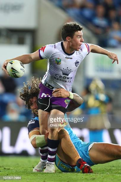 Brodie Croft of the Storm passes during the round 24 NRL match between the Gold Coast Titans and the Melbourne Storm at Cbus Super Stadium on August...