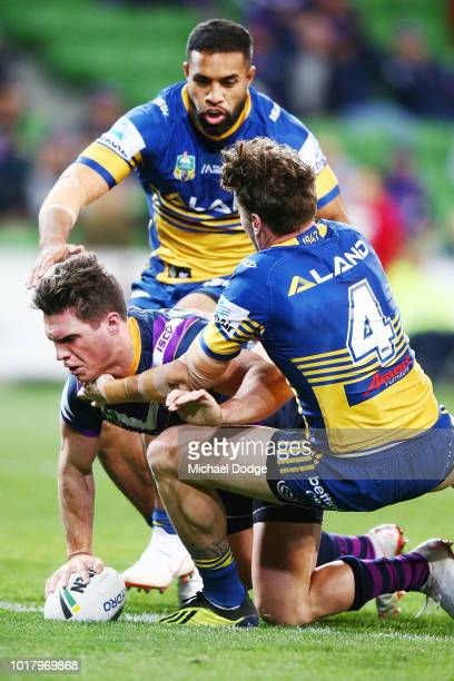 Brodie Croft of the Storm scores a try against Clinton Gutherson of the Eels that was later overturned during the round 23 NRL match between the...