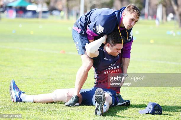 Brodie Croft of the Storm stretches during a Melbourne Storm NRL training session at Gosch's Paddock on September 11 2018 in Melbourne Australia