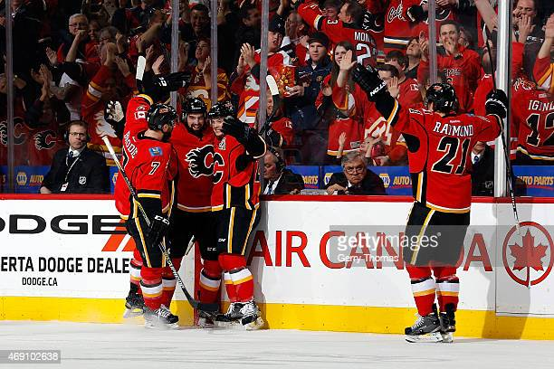 Brodie David Schlemko Jiri Hudler and Mason Raymond of the Calgary Flames celebrate a goal against the Los Angeles Kings at Scotiabank Saddledome on...