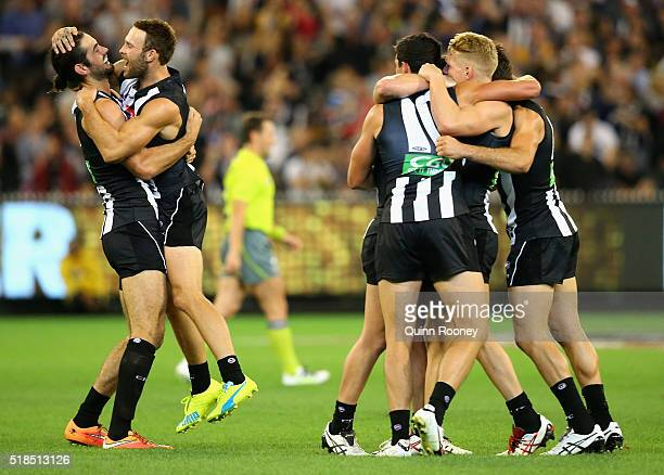 Brodie Grundy Brent Macaffer Adam Treloar Taylor Adams and Scott Pendlebury of the Magpies celebrate winning the round two AFL match between the...