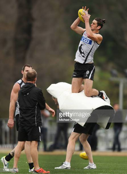 Brodie Grundy marks the ball during a Collingwood Magpies AFL training session at Olympic Park on September 6 2013 in Melbourne Australia