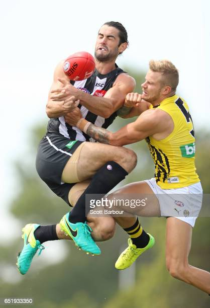 Brodie Grundy of the Magpies and Brandon Ellis of the Tigers compete for the ball during the 2017 JLT Community Series AFL match between the Richmond...