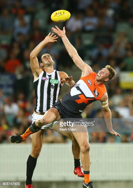 Brodie Grundy of the Magpies and Dawson Simpson of the Giants contest possession during the JLT Community Series AFL match between the Greater...