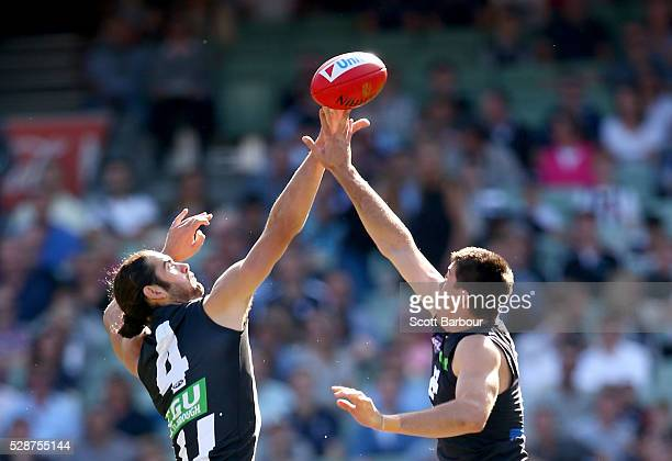 Brodie Grundy of the Magpies and Matthew Kreuzer of the Blues compete for the ball during the round seven AFL match between the Collingwood Magpies...