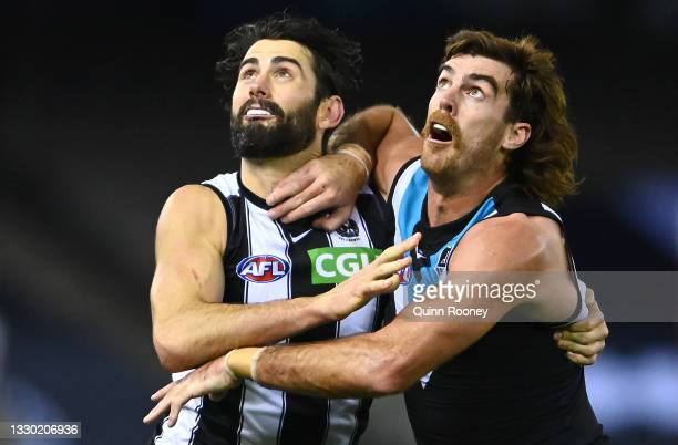 Brodie Grundy of the Magpies and Scott Lycett of the Power compete in the ruck during the round 19 AFL match between Port Adelaide Power and...