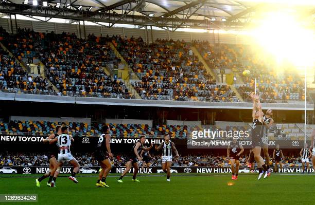 Brodie Grundy of the Magpies and Tom De Koning of Carlton challenge for the ball during the round 14 AFL match between the Carlton Blues and the...
