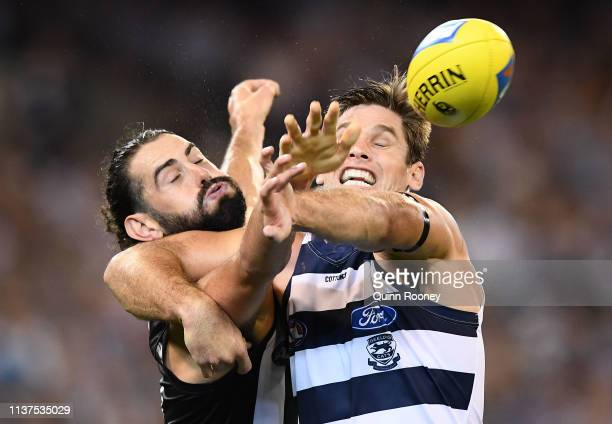 Brodie Grundy of the Magpies and Tom Hawkins of the Cats compete in the ruck during the round one AFL match between the Collingwood Magpies and the...