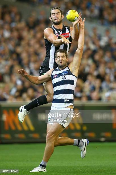 Brodie Grundy of the Magpies attempts to mark over the top of Jared Rivers of the Cats during the round three AFL match between the Collingwood...