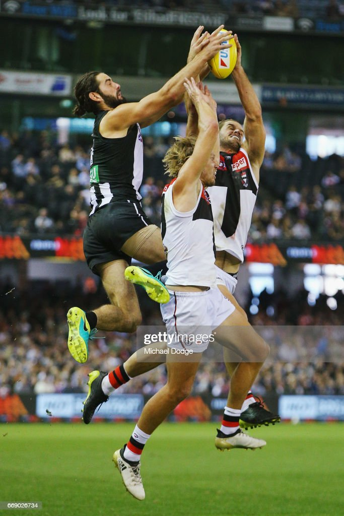 Brodie Grundy of the Magpies (L) competes for the ball against Josh Bruce of the Saints during the round four AFL match between the Collingwood Magpies and the St Kilda Saints at Etihad Stadium on April 16, 2017 in Melbourne, Australia.