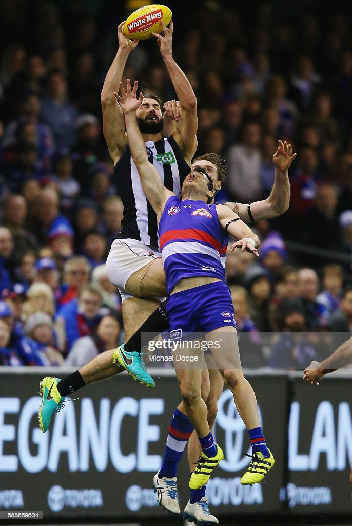 Brodie Grundy of the Magpies competes for the ball over Tory Dickson of the Bulldogs during the round 21 AFL match between the Western Bulldogs and the Collingwood Magpies at Etihad Stadium on August 12, 2016 in Melbourne, Australia.