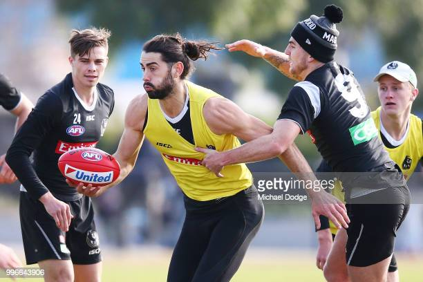 Brodie Grundy of the Magpies is tackled by Sam Murray of the Magpies during a Collingwood Magpies AFL training session at the Holden Centre on July...