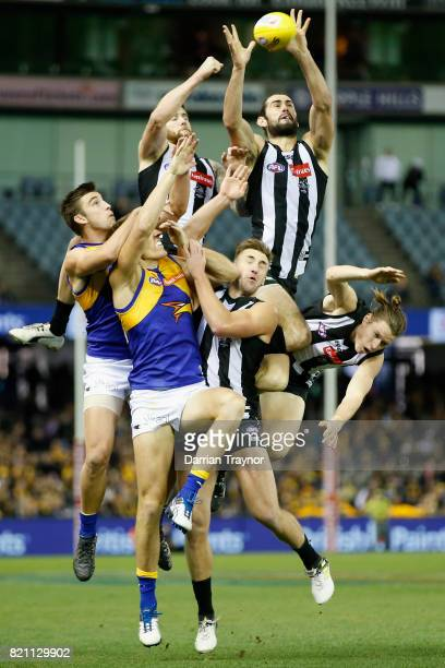 Brodie Grundy of the Magpies leaps for the ball during the round 18 AFL match between the Collingwood Magpies and the West Coast Eagles at Etihad...