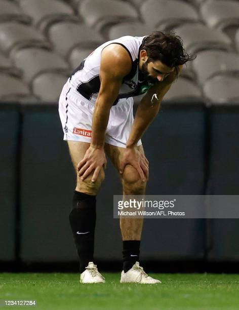 Brodie Grundy of the Magpies looks dejected after a loss during the 2021 AFL Round 19 match between the Port Adelaide Power and the Collingwood...