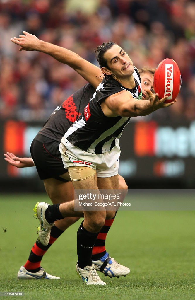 Brodie Grundy of the Magpies marks the ball against Tom Bellchambers of the Bombersduring the round four AFL match between the Essendon Bombers and the Collingwood Magpies at Melbourne Cricket Ground on April 25, 2015 in Melbourne, Australia.