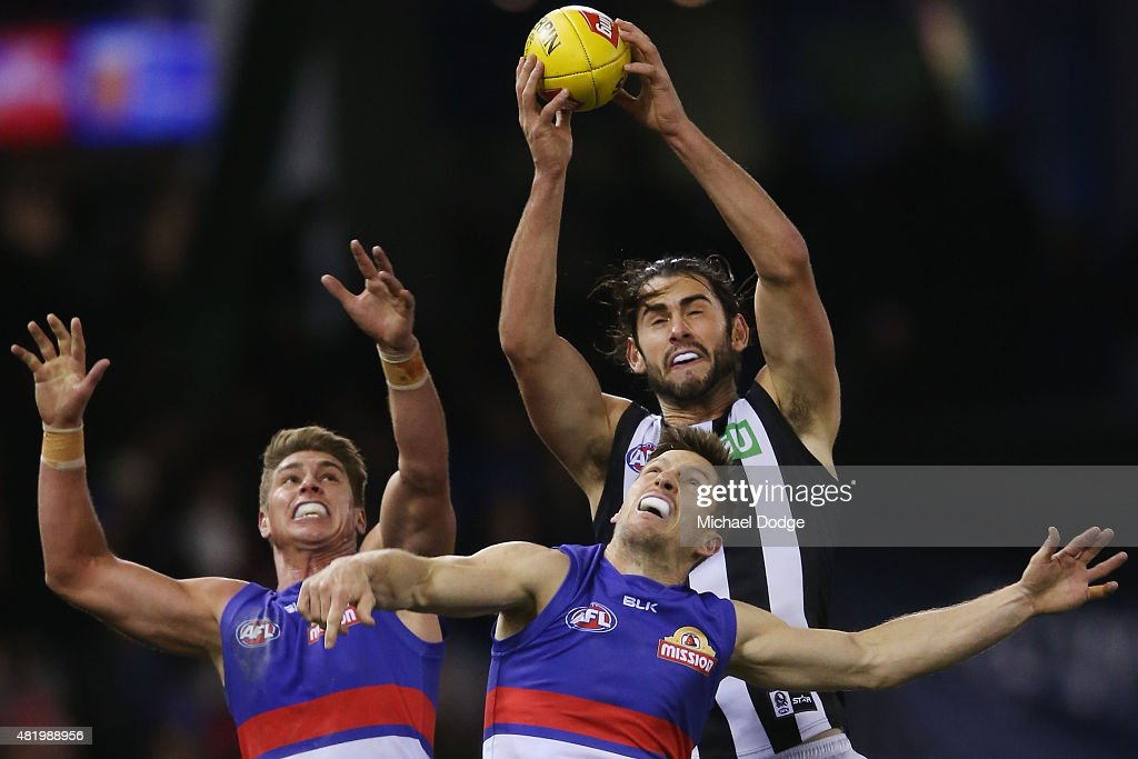 Brodie Grundy of the Magpies marks the ball over Matthew Boyd of the Bulldogs during the round 17 AFL match between the Western Bulldogs and the Collingwood Magpies at Etihad Stadium on July 26, 2015 in Melbourne, Australia.