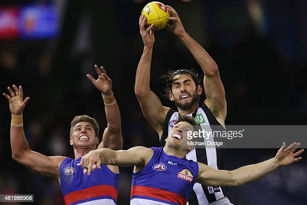 Brodie Grundy of the Magpies marks the ball over Matthew Boyd of the Bulldogs during the round 17 AFL match between the Western Bulldogs and the...
