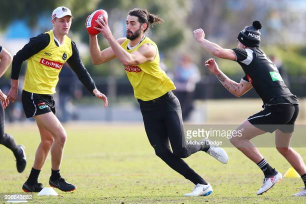 Brodie Grundy of the Magpies runs with the ball during a Collingwood Magpies AFL training session at the Holden Centre on July 12 2018 in Melbourne...