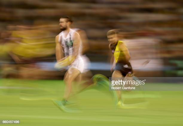 Brodie Grundy of the Magpies runs with the ball during the round two AFL match between the Richmond Tigers and the Collingwood Magpies at Melbourne...