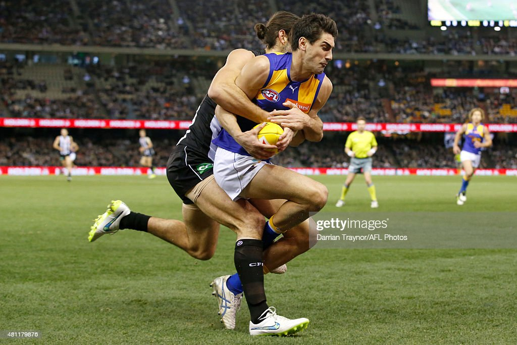 Brodie Grundy of the Magpies tackles Matt Rosa of the Eagles during the round 16 AFL match between the Collingwood Magpies and the West Coast Eagles at Etihad Stadium on July 18, 2015 in Melbourne, Australia.