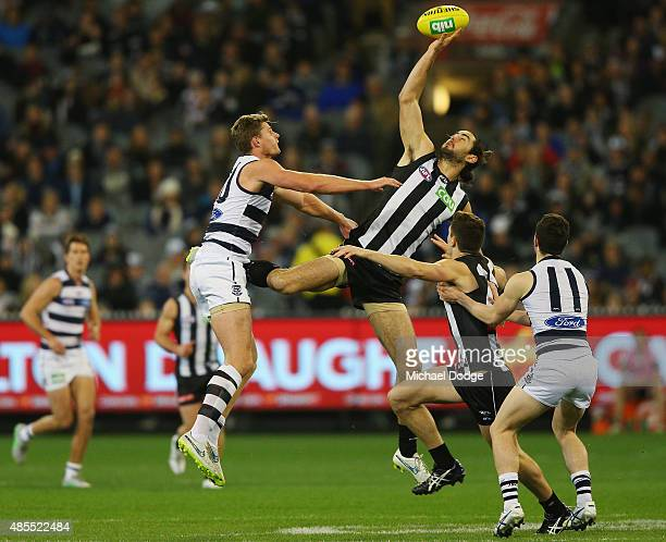 Brodie Grundy of the Magpies wins the tap out against Nathan Vardy of the Cats during the round 22 AFL match between the Geelong Cats and the...