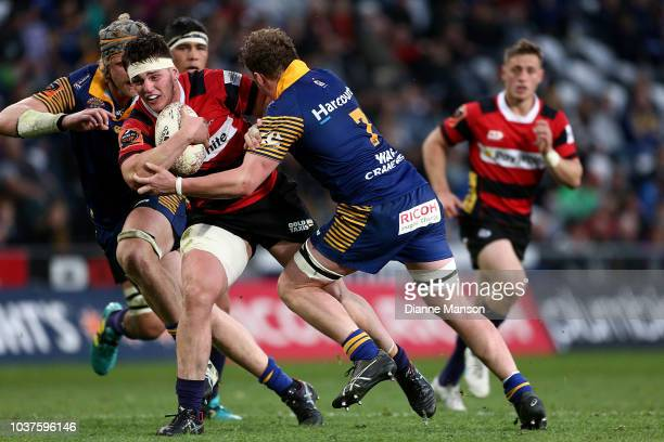 Brodie McAlister of Canterbury is tackled by Slade McDowall of Otago during the round six Mitre 10 Cup match between Otago and Canterbury at Forsyth...