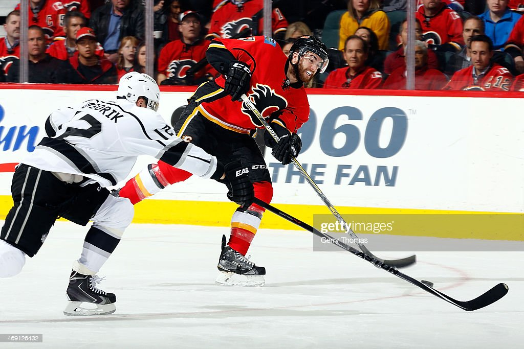 TJ Brodie #7 of the Calgary Flames shoots the puck against the Los Angeles Kings at Scotiabank Saddledome on April 9, 2015 in Calgary, Alberta, Canada.