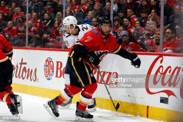 Brodie of the Calgary Flames skates against Nick Bjugstad of the Florida Panthers during an NHL game on February 17 2018 at the Scotiabank Saddledome...